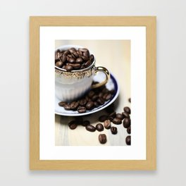 Coffee beans in the old cappuccino cup Framed Art Print