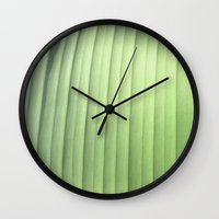 banana leaf Wall Clocks featuring Banana Leaf Close by Glenn Designs
