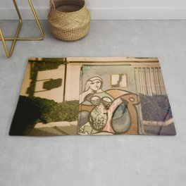 Woman on Electrical Box with Toy Horse  Rug