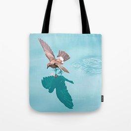 Storm petrel dancing on the ocean Tote Bag
