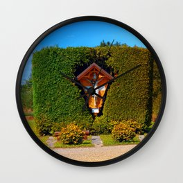 Jesus, a cross and a trimmed bush Wall Clock