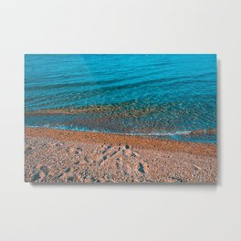 stony beach in orange colors with clean water Metal Print