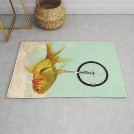unicycle gold fish -2 Rug