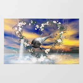 Dolphin jumps by a heart Rug