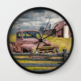 Pickup Truck behind wooden fence in a Rural Landscape Wall Clock