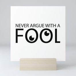 Never argue with a fool Mini Art Print
