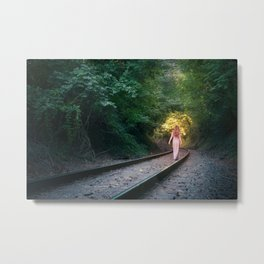 Woman walking on railroad tracks towards the light Metal Print