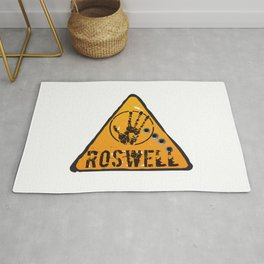 Roswell road sign Rug