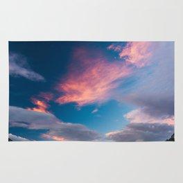 Amazing sunset clouds over mountain Mangart Rug