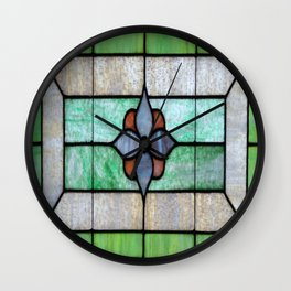 Stained Glass features a picture of a classic stained glass window typically found above a door Wall Clock