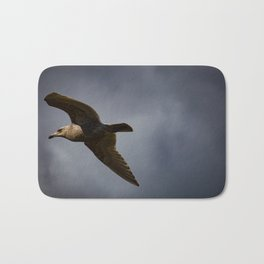 Storm Chaser - Bird flying in Sky Bath Mat