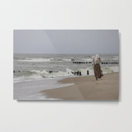 Young girl walking on the sea beach Metal Print