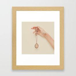 The hand that holds Framed Art Print