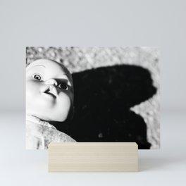 Creepy, disturbing doll portrait in black and white Mini Art Print