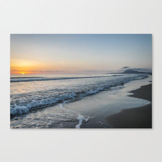 Sunrise on a mediterranean beach Canvas Print