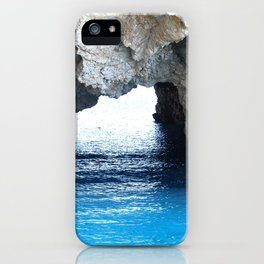 Rocks created a natural arch over crystal blue water iPhone Case