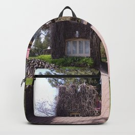 Beautiful Rock Building With Stone Path Through It Surrounded by Green Backpack