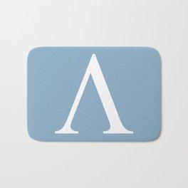 Greek letter lambda sign on placid blue background Bath Mat
