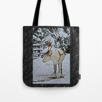 finland Tote Bags featuring Reindeer in Lapland Finland by Guna Andersone & Mario Raats - G&M Studi