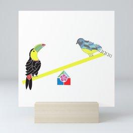 Birds on a seesaw Mini Art Print