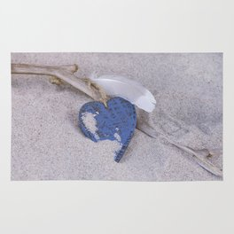 Blue Heart and feather on the Beach Rug