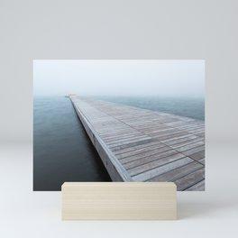 Foggy jetty Mini Art Print