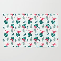 pink flamingo bird on blue and green tropical pattern Rug