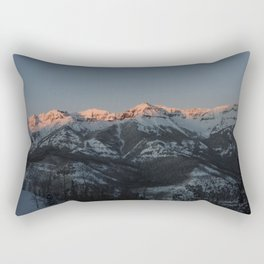 The majestic peaks of the Teton Range reflect in a mountain stream in Grand Teton National Park in n Rectangular Pillow