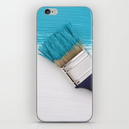 Teal paint and paintbrush iPhone Skin