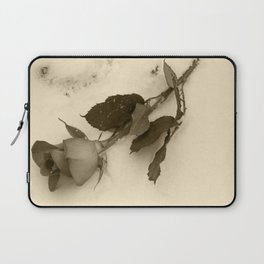 A lone rose resting in the snow Laptop Sleeve