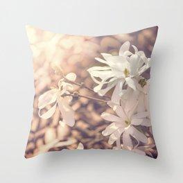white blossom of star magnolia in sunlight Throw Pillow