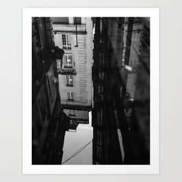 Urban reflection. Manchester architecture reflected in a street puddle. Art Print