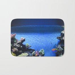 Fish in blue tank Bath Mat