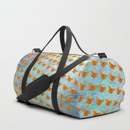 Orange butterflies flying in formation Duffle Bag