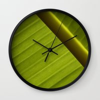 banana leaf Wall Clocks featuring Banana Leaf by Maria Heyens