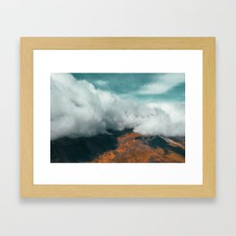Clouds rolling down mountain Iceland Framed Art Print