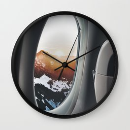 snowy mountains from a plane window Wall Clock