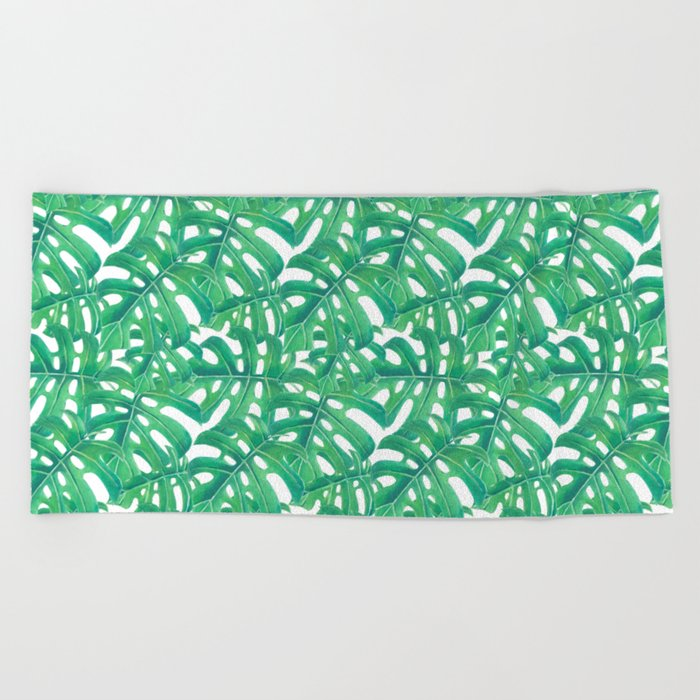 Green monstera tropical leaves pattern  on white background Beach Towel