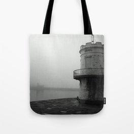 misty harbour lighthouse Tote Bag