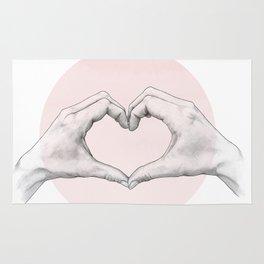 heart in hands // hand study Rug