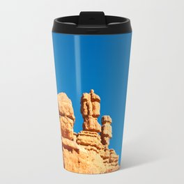 The Totem Heads of Red Canyon Travel Mug