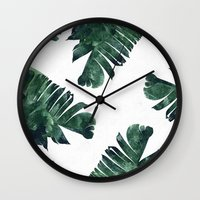 banana leaf Wall Clocks featuring Banana Leaf Watercolor Pattern #society6 by 83 Oranges™