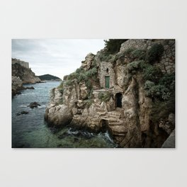 Doors in the cliff Canvas Print