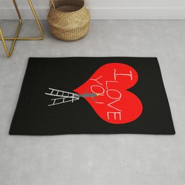 A Woman Worker Stands On A Step Ladder And Chisels I Love You In Red Heart. Black Background Rug