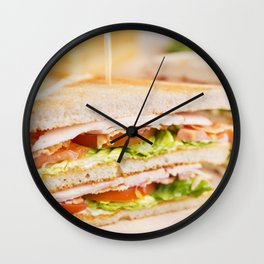 Club sandwich on a rustic table in bright light Wall Clock