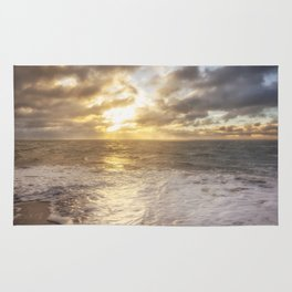 A beautiful sunrise over the ocean. Rug