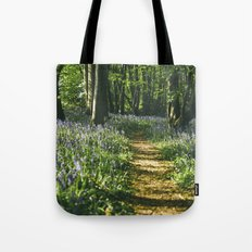 Path through wild Bluebells in ancient woodland. Wayland Wood, Norfolk, UK. Tote Bag