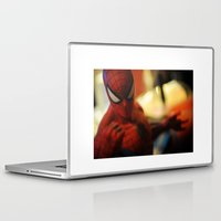 spider man Laptop & iPad Skins featuring spider-man  by caporilli