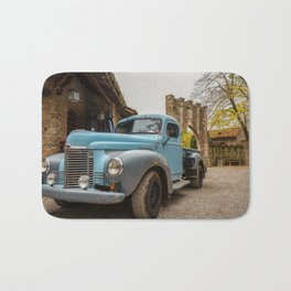 Historic blue-colored pickup parked in the streets of an historic Italian village Bath Mat