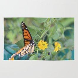 Monarch on Lantana flower Rug